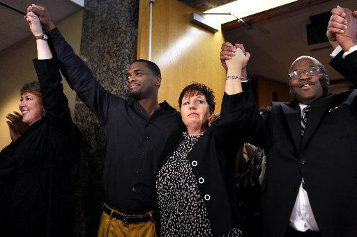 Attorney Michelle Moore, Christopher Scott, UTA Innocence Network Vice President Natalie Ellis, and Claude Alvin Simmons Jr. exit Criminal District Court No. 1 in 2009 after Scott and Simmons were exonerated after being wrongly convicted of capital murder 12 years ago at the Frank Crowley Courts Building. (FILE PHOTO)