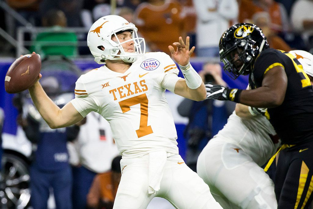 FILE - Texas quarterback Shane Buechele (7) throws a pass under pressure from Missouri defensive lineman Jordan Harold (55) during the first quarter of the Texas Bowl on Wednesday, Dec. 27, 2017, in Houston. (Smiley N. Pool/The Dallas Morning News)