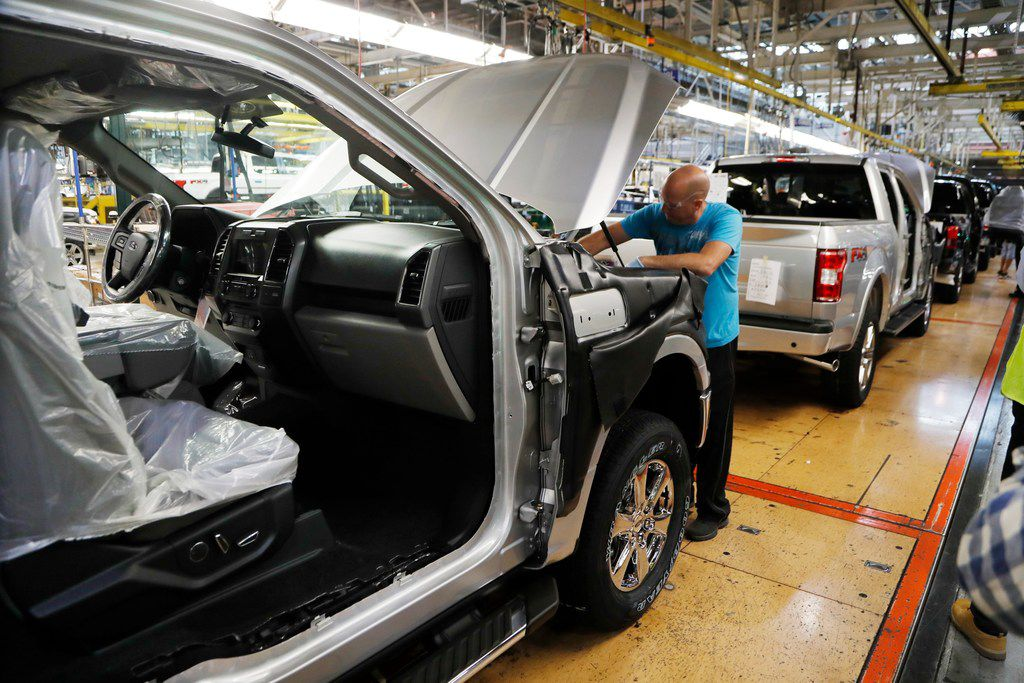A United Auto Workers assemblyman works on a 2018 Ford F-150 truck being assembled at the Ford Rouge assembly plant in Dearborn, Mich.