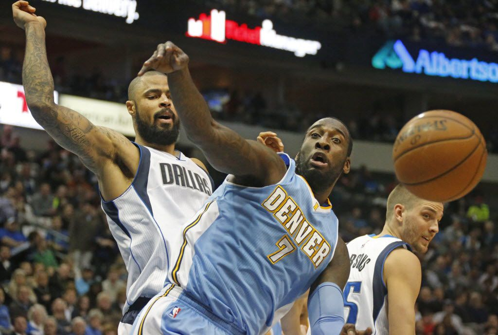Dallas' Tyson Chandler, left, and Chandler Parsons, right, battle for a rebound with JJ Hickson (7) in the second quarter during the Denver Nuggets vs. the Dallas Mavericks NBA basketball game at the American Airlines Center in Dallas on Friday, January 16, 2015.  (Louis DeLuca/The Dallas Morning News)