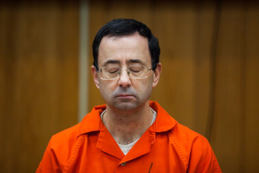 In this Feb. 5, 2018, file photo, Larry Nassar listens during his sentencing at Eaton County Circuit Court in Charlotte, Mich.