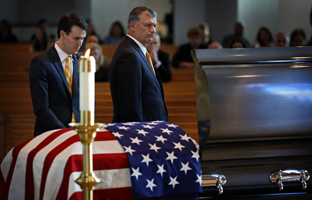 Dallas Mayor Mike Rawlings (right) and his son, Gunnar Rawlings, visit the casket of slain Dallas police Sgt. Michael Smith during a visitation for his body Tuesday, July 12, 2016 at Mary Immaculate Catholic Church in Farmers Branch, Texas.  (G.J. McCarthy/The Dallas Morning News)