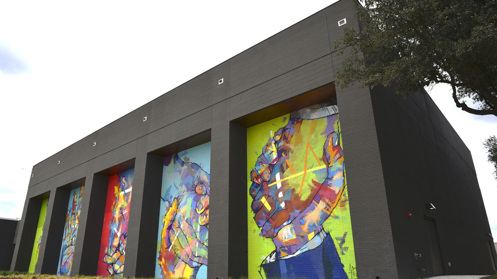 Murals by Spanish artist Adrian Torres decorate the fitness center on the campus of Legacy Central.