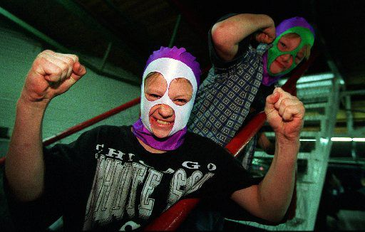 "Oak Cliff wrestling fans John ""Smokey"" Buford and his  friend Willie ""Tag"" Page, both 13, put on the wrestling masks they'd just bought at a souvenir stand before watching a regular Friday night show at the Sportatorium in 1996."