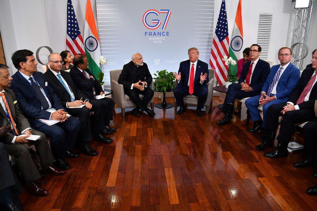 Indian Prime Minister Narendra Modi and President Donald Trump speak during a bilateral meeting in Biarritz on Aug. 26, 2019, on the third day of the annual G7 Summit.
