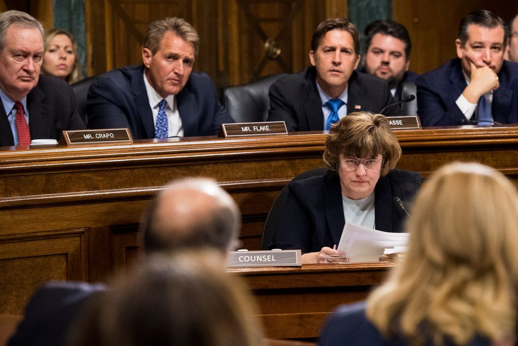 Rachel Mitchell, counsel for Senate Judiciary Committee Republicans, questions Christine Blasey Ford during the Senate Judiciary Committee hearing on the nomination of Brett M. Kavanaugh, on Thursday, Sept. 27, 2018, on Capitol Hill in Washington.  Senators behind are (from left) Sen. Mike Crapo, R-Idaho, Sen. Jeff Flake, R-Ariz., Sen. Ben Sasse, R-Neb. and Sen. Ted Cruz, R-Texas.