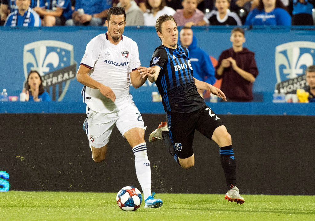 Montreal Impact's Lassi Lappalainen, right, challenges FC Dallas' Matt Hedges during second-half MLS soccer match action in Montreal, Saturday, Aug. 17, 2019. (Graham Hughes/The Canadian Press via AP)