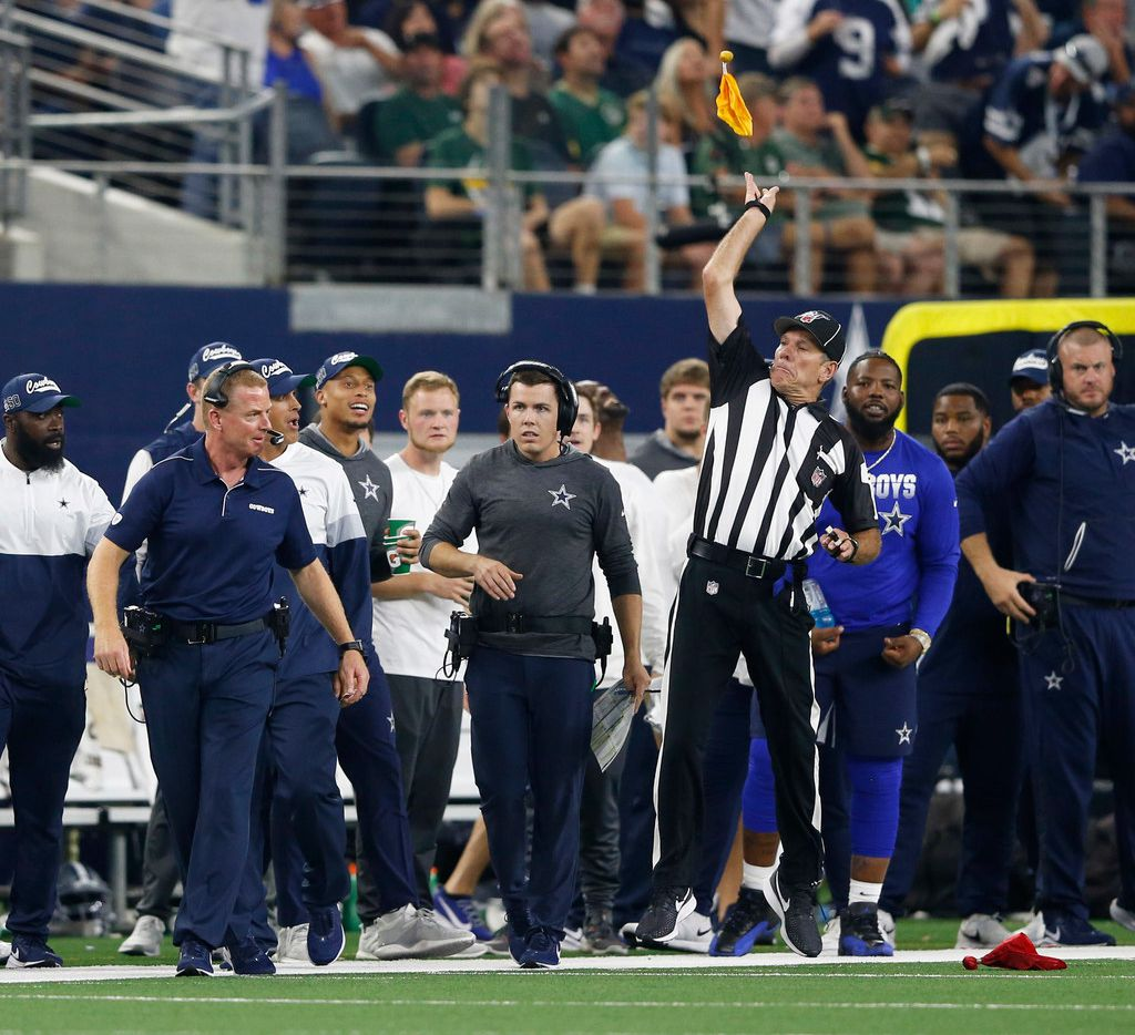 Side judge Scott Edwards (3) throws a penalty flag after Dallas Cowboys head coach Jason Garrett threw a challenge flag during the second half of play at AT&T Stadium in Arlington, Texas on Sunday, October 6, 2019. The Green Bay Packers defeated the Dallas Cowboys 34-24. (Vernon Bryant/The Dallas Morning News)