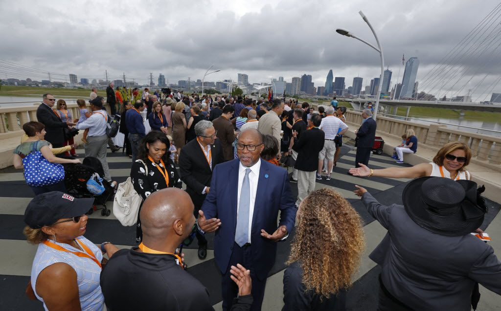 Ambassador Ron Kirk is greeted  before the dedication ceremony for the Ronald Kirk Pedestrian Bridge in Dallas on June 4, 2016.