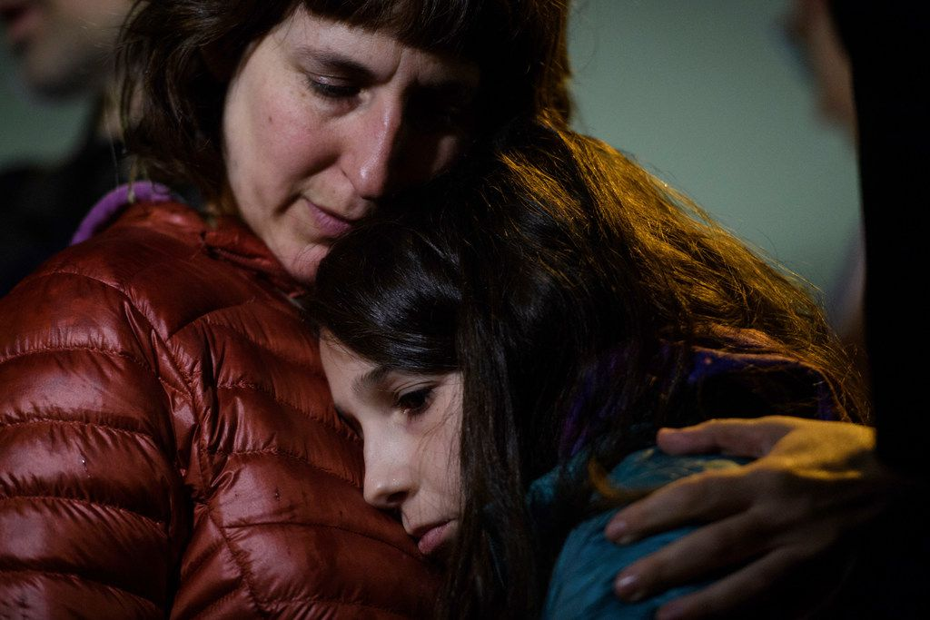 Rachel Kranson holds her daughter, Sasha Kranson, 12, during a vigil after a man fatally shot 11 at Tree of Life Congregation synagogue in Pittsburgh.
