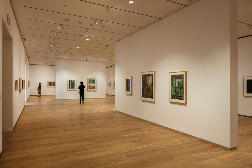 """Brown Foundation Gallery featuring """"The Condition of Being Here: Drawings by Jasper Johns.""""  Photos of the Louisa Stude Sarofim Building housing the Menil Drawing Institute, at the Menil Collection in Houston."""