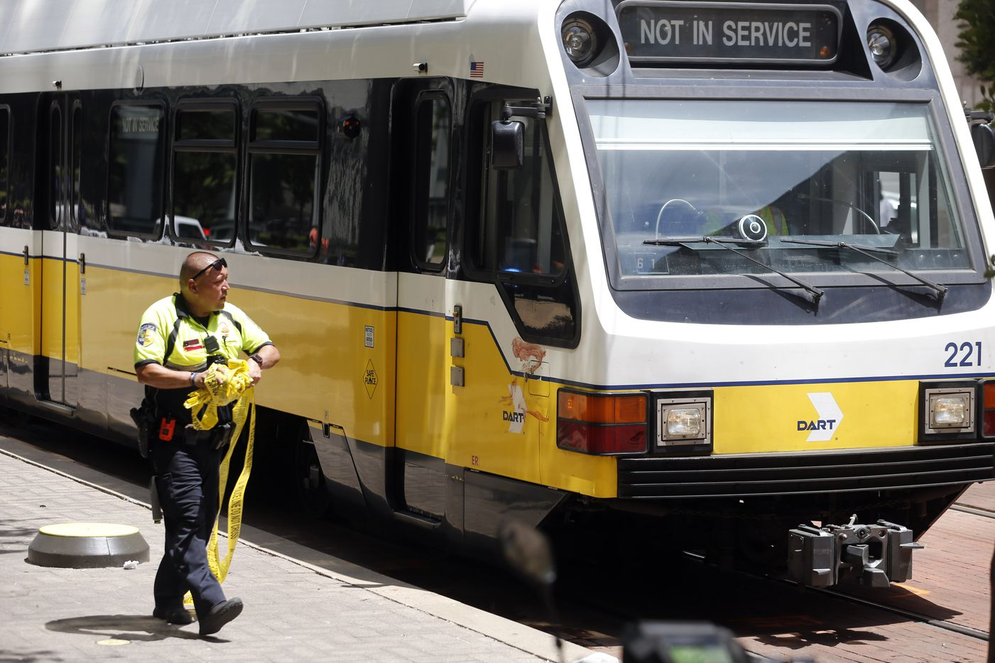 DART police remove caution tape as a train prepares to move forward after a Dallas police officer was hit by a DART train near the intersection of Bryan St. and Olive St. in downtown Dallas on Tuesday, August 13, 2019.