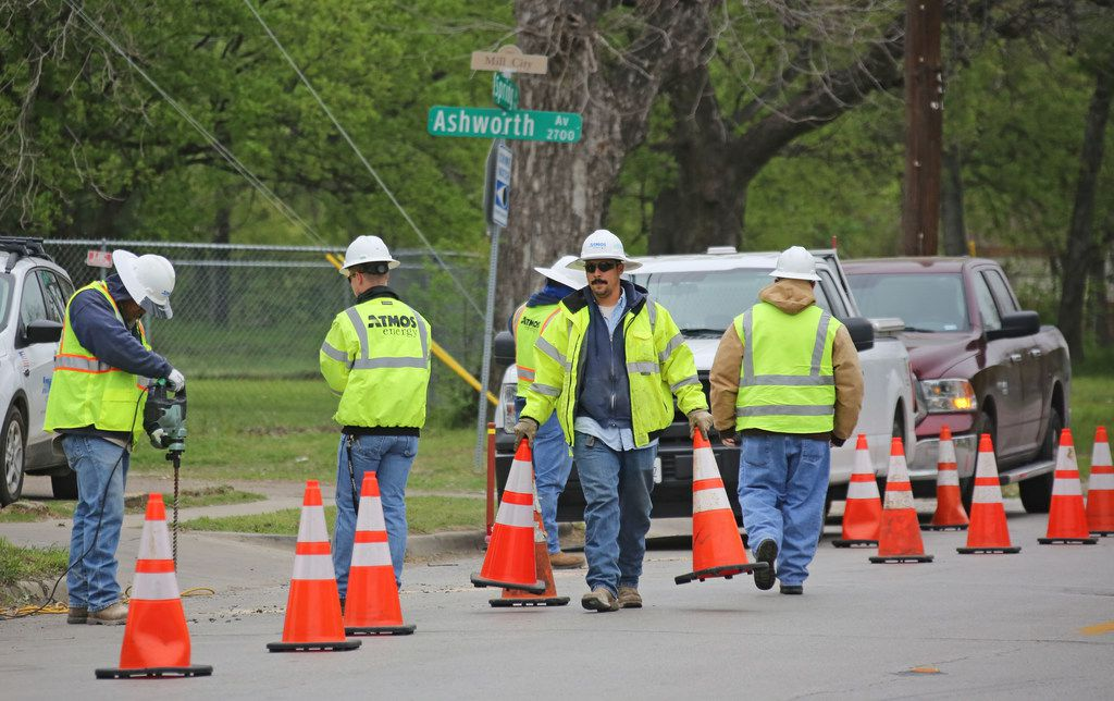 Atmos workers investigate a house explosion at 3700 Spring Avenue in Dallas, near Fair Park, on Monday, April 2, 2018.