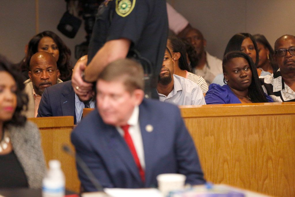 Charmaine Edwards (right) and her husband, Odell Edwards, listen as their son's killer is sentenced to 15 years in prison Wednesday. (Rose Baca/Staff Photographer)