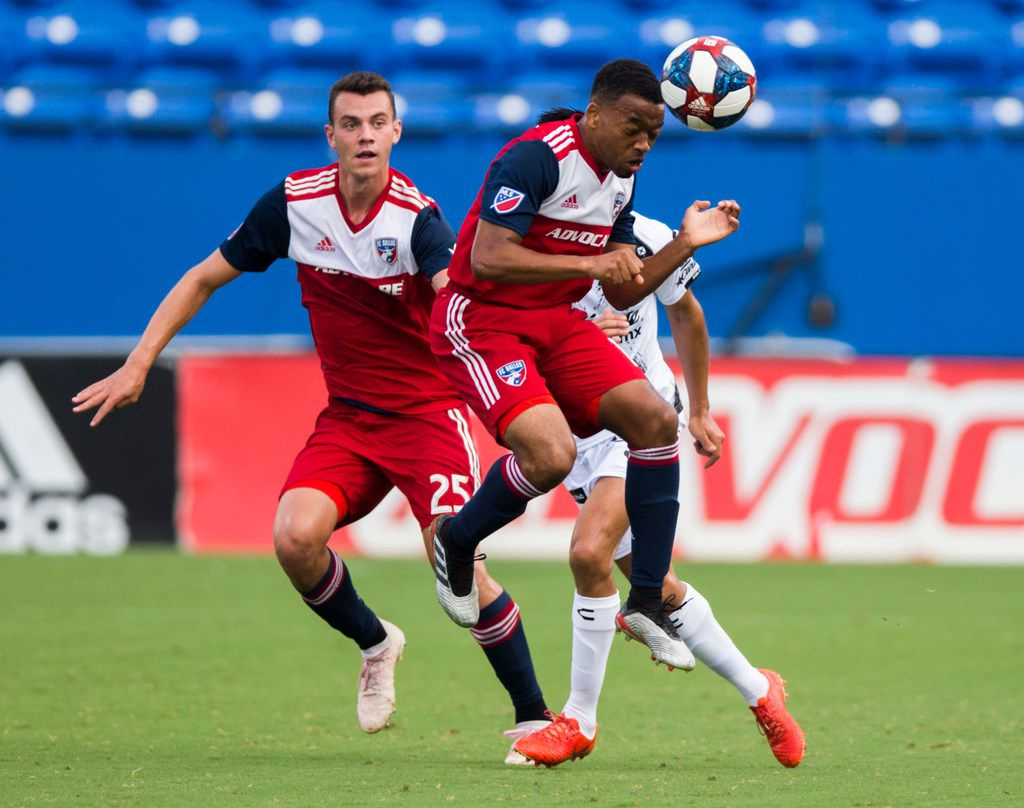 FC Dallas midfielder Jacori Hayes (15) heads the ball ahead of defender Callum Montgomery (25) and Club Tijuana midfielder Washington Camacho (11) during the first half of a friendly MLS game between FC Dallas and Club Tijuana on Sunday, July 7, 2019 at Toyota Stadium in Friso. (Ashley Landis/The Dallas Morning News)