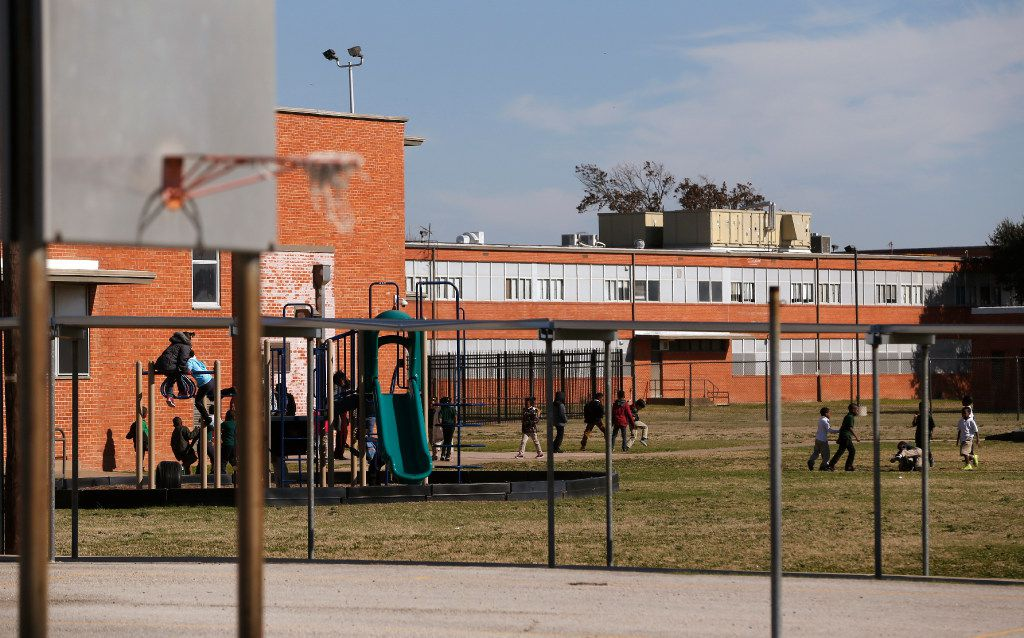 Children at the playground at George W. Carver Elementary School in Dallas on January 26, 2017.