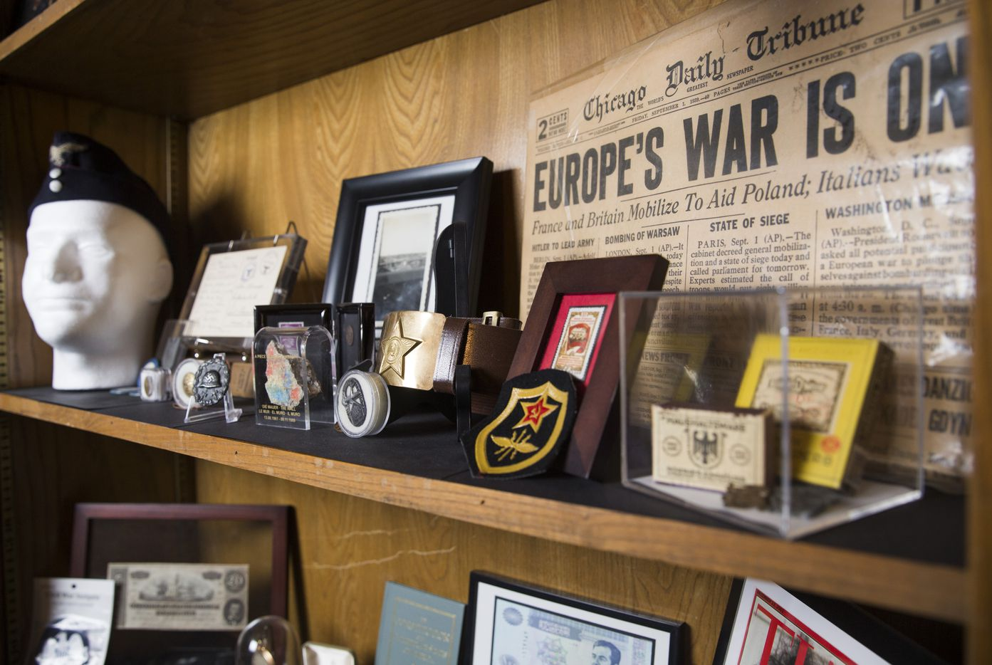 Military memorabilia sits on a shelf in the bedroom of Andy Fancher, 18, on Wednesday, July 12, 2017 at his home in Duncanville.