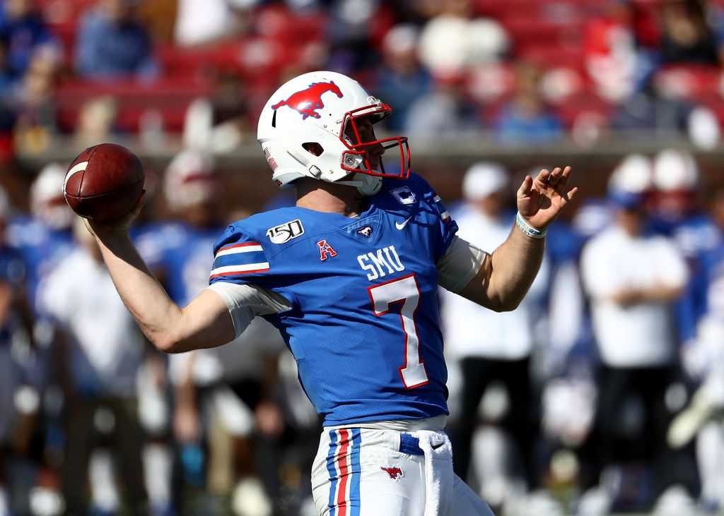 DALLAS, TEXAS - NOVEMBER 09:  Shane Buechele #7 of the Southern Methodist Mustangs throws against the East Carolina Pirates in the first half at Gerald J. Ford Stadium on November 09, 2019 in Dallas, Texas. (Photo by Ronald Martinez/Getty Images)