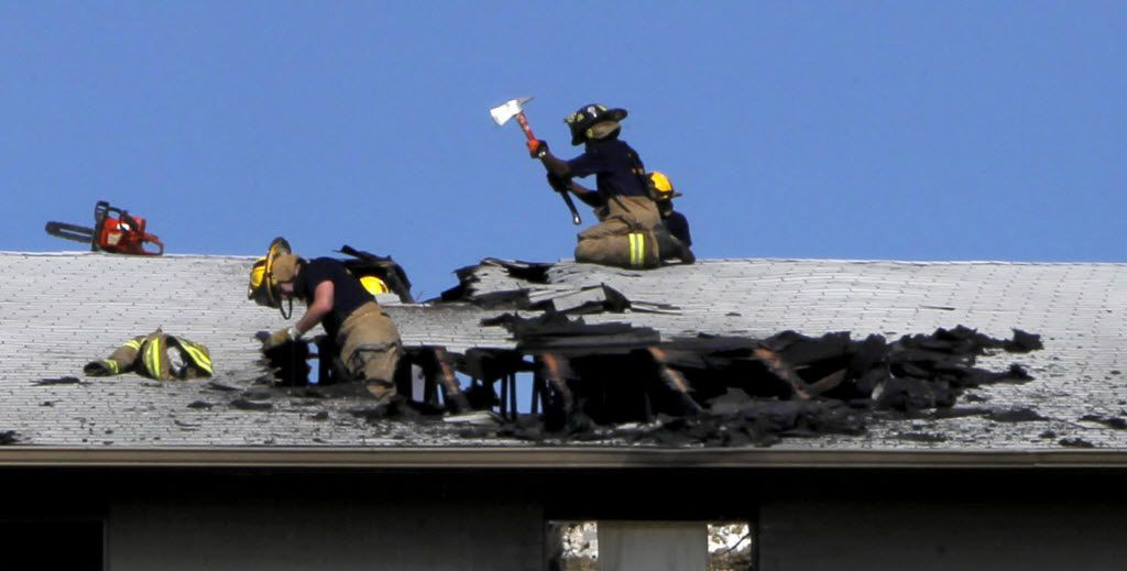 Dallas firefighters worked on the roof where a fellow firefighter fell through and was taken to the hospital at Ridgecrest Terrace Apartments in August 2011. Lt. Todd Krodle, an 18-year Dallas Fire-Rescue veteran, died after falling through the roof of the burning west Oak Cliff apartment building.