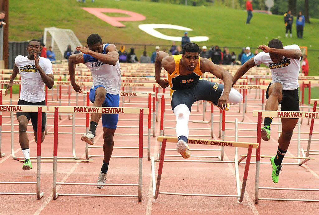 Ezekiel Elliott  (second from right) of John Burrough's won the 110 High Hurdles Friday afternoon at the Henle Holmes Invitational in a time of 14.38. From left to right are Chris Orange of lafayette, Jehu Chesson of Ladue, Elliott, and Chris Caldwell of Lafayette. The race featured four of the top five hurdlers in the region. (Rick Graefe/Suburban Journals of Greater St. Louis)
