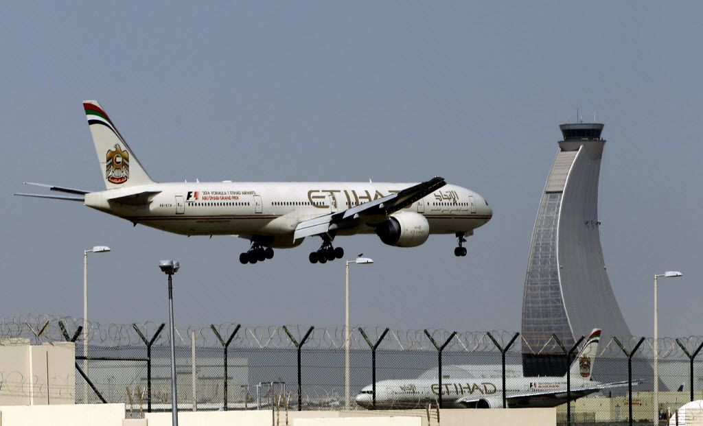 An Etihad Airways plane prepares to land at the Abu Dhabi airport in United Arab Emirates.