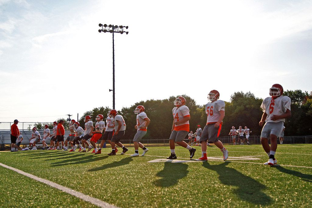 Players run drills during the first week of football practice for Celina High School at Bobcat Stadium on Wednesday, August 8, 2018. (Stewart F. House/Special Contributor)