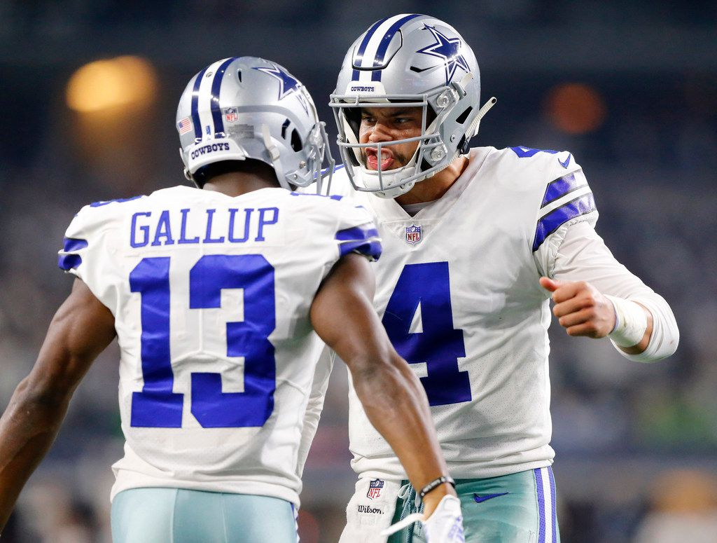 Dallas Cowboys wide receiver Michael Gallup (13) is congratulated on his second quarter touchdown catch by quarterback Dak Prescott (4) in their NFC Wild Card game at AT&T Stadium in Arlington, Texas, Saturday, January 5, 2019. (Tom Fox/The Dallas Morning News)