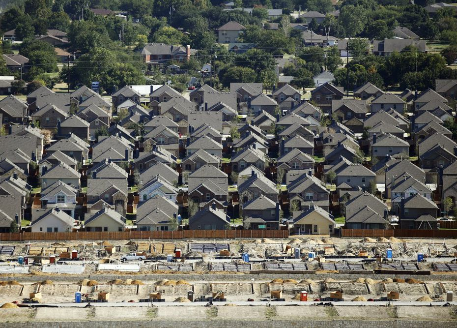 In an aerial view, you can make out an established neighborhood, new homes and homes under construction in McKinney.