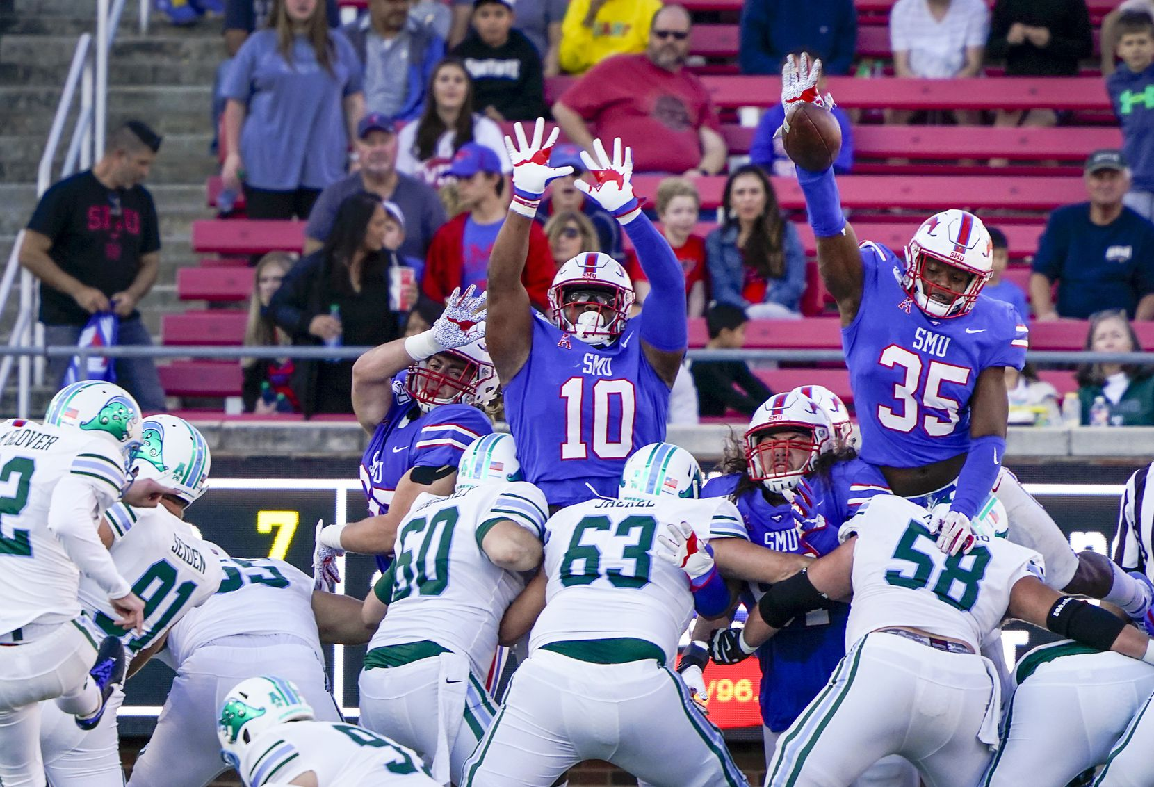 SMU defensive end Delontae Scott (35) blocks a field goal attempt by Tulane place kicker Merek Glover during the first half of an NCAA football game at Ford Stadium on Saturday, Nov. 30, 2019, in Dallas.