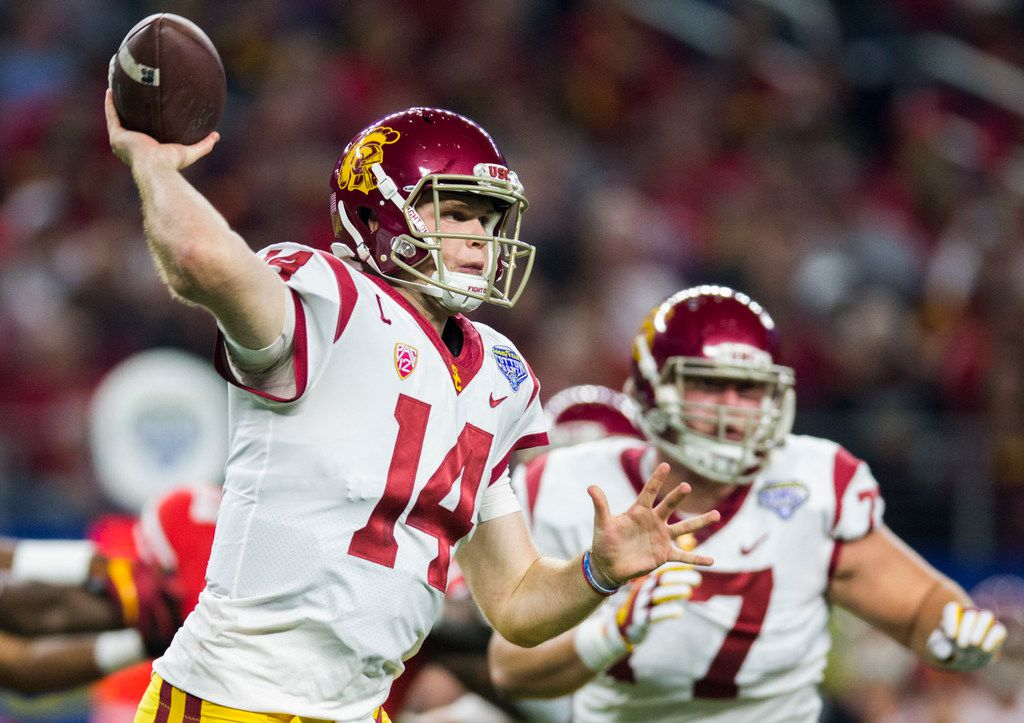 FILE - USC quarterback Sam Darnold (14) throws a pass during the second quarter of the Cotton Bowl Game against Ohio State on Friday, Dec. 29, 2017, at AT&T Stadium in Arlington. (Ashley Landis/The Dallas Morning News)