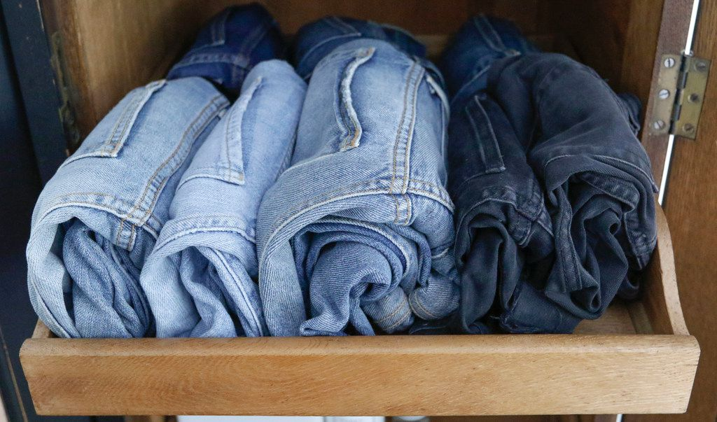 Caroline Rector's rolled jeans are packed neatly in a cubby and easy to see.