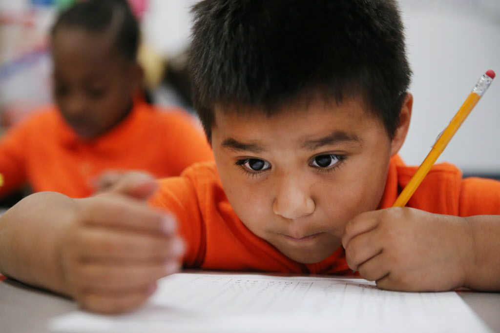 Gerardo Quijas, 6, works on a math exercise in the first grade class of teacher Brittany Hughes inside the KIPP Truth Elementary School in the Oak Cliff neighborhood of Dallas on February 1, 2016.  (Andy Jacobsohn/The Dallas Morning News)