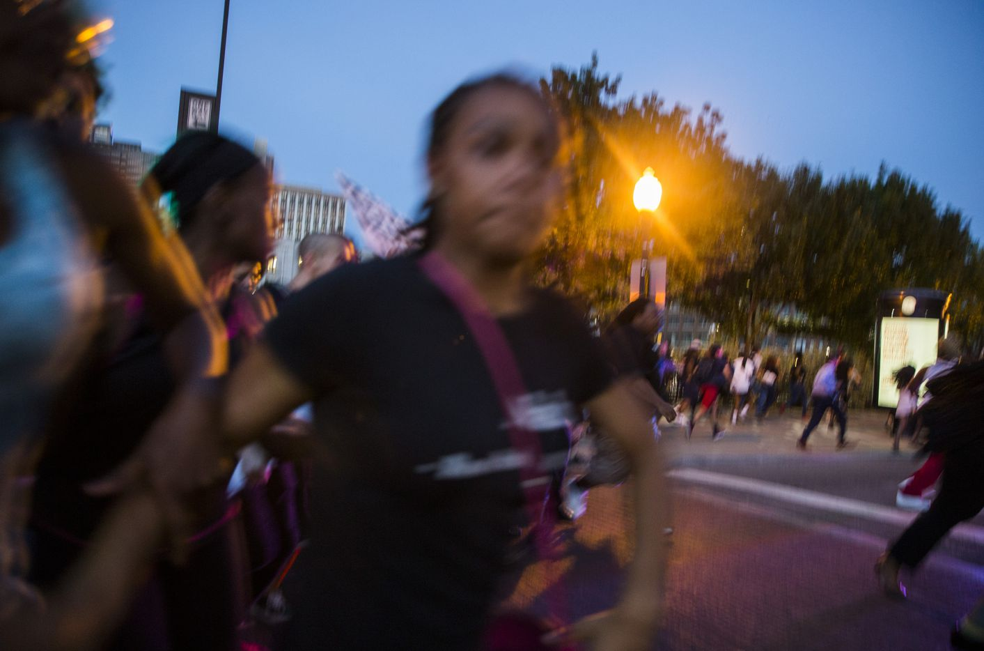 People run at the corner of Commerce and South Market streets after shots were fired following a Black Lives Matter protest. (Ashley Landis/Staff Photographer)