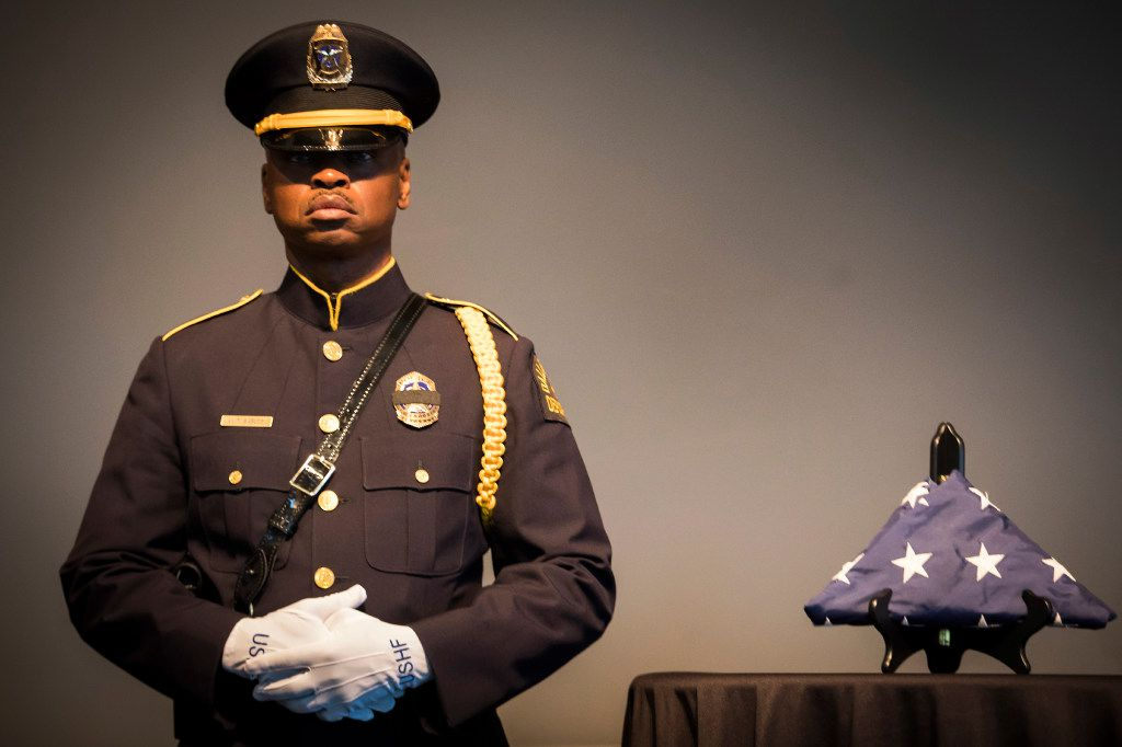 Dallas Police Sgt. Michael Bables stood beside the U.S. Honor Flag at Dallas police headquarters during a round-the-clock vigil a year ago to commemorate fallen officers. (File photo)