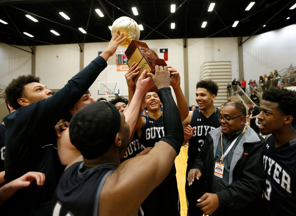Denton Guyer players hoist a championship trophy after defeating Lakeview Centennial 75-73 in the championship game of the Whataburger Basketball Tournament at W. G. Thomas Coliseum in Haltom City, Friday, Dec. 30, 2016. (Jae S. Lee/The Dallas Morning News)