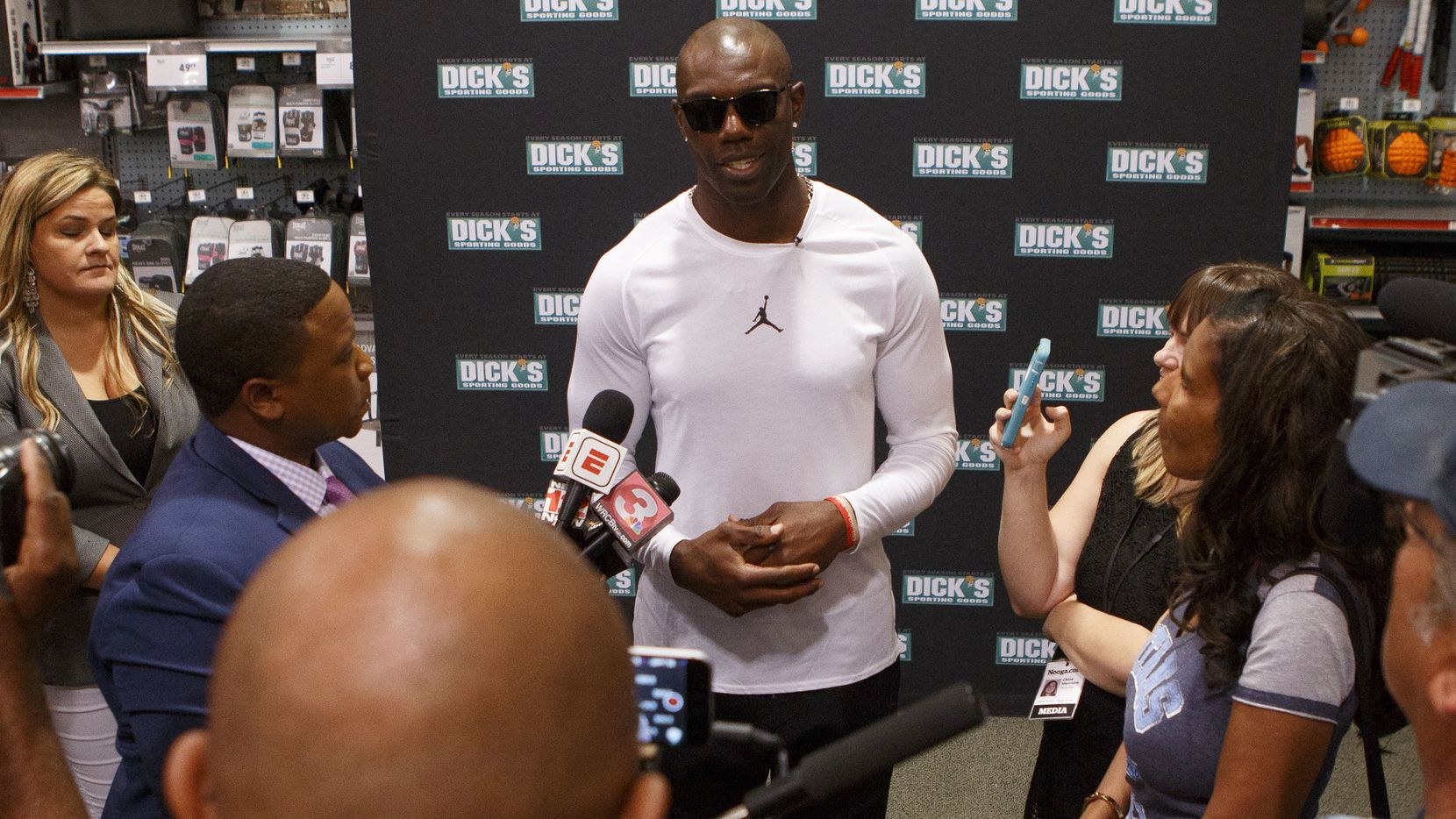 Former University of Tennessee at Chattanooga wide receiver and National Football League Hall of Fame inductee Terrell Owens speaks to the media at Dick's Sporting Goods on Friday, Aug. 3, 2018 in Chattanooga, Tenn. Owens, who is foregoing the traditional Hall of Fame ceremony, is spending the weekend celebrating his induction in Chattanooga.  (C.B. Schmelter/Chattanooga Times Free Press via AP)