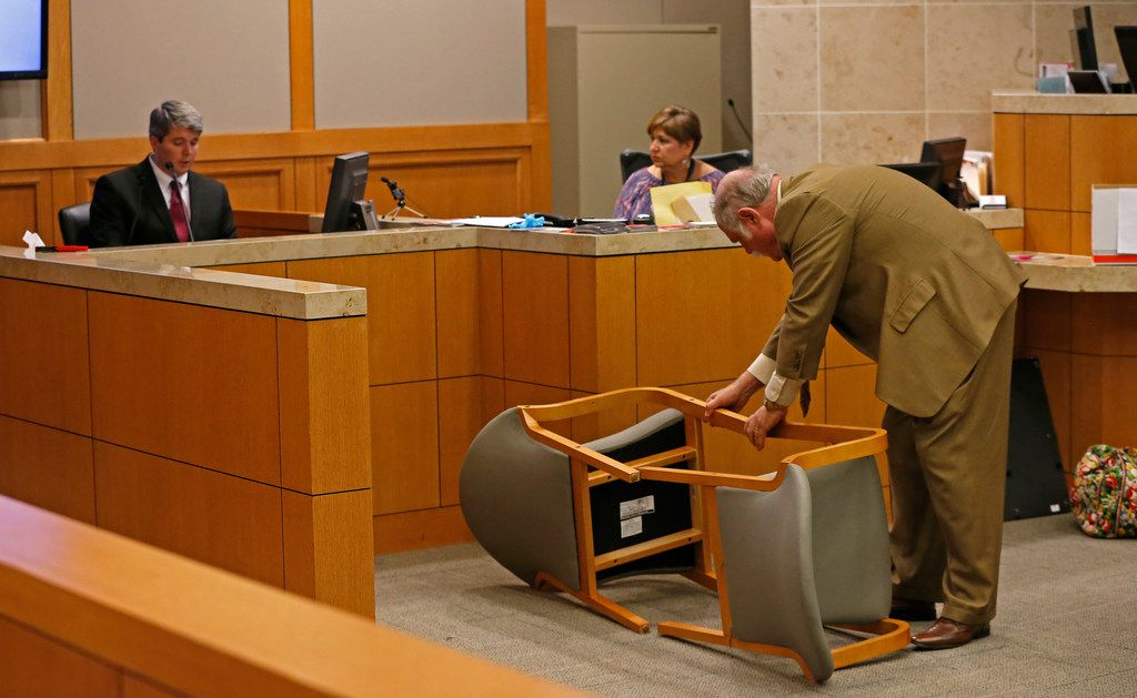 Defense attorney Andrew Farkas (right) rearranges two chairs on their side while defendant Jason Lowe (left) testifies during his murder trial at Collin County Courthouse in McKinney on Monday, Sept. 18, 2017.