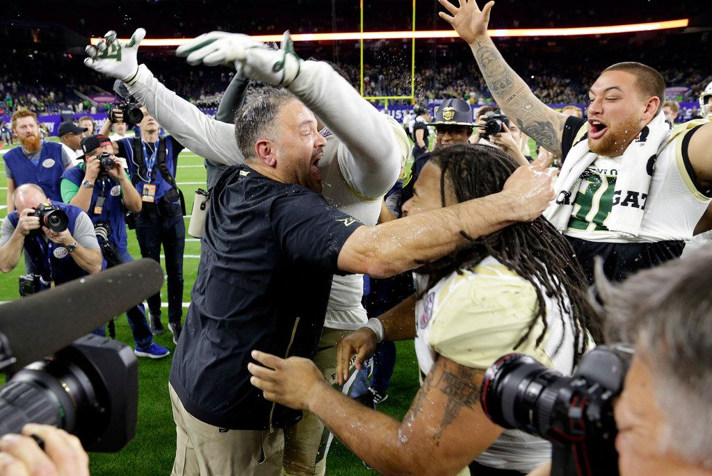 Baylor head coach Matt Rhule, center left, embraces his players as they celebrate their 45-38 win over Vanderbilt after the Texas Bowl NCAA college football game, Thursday, Dec. 27, 2018, in Houston. (AP Photo/Michael Wyke)
