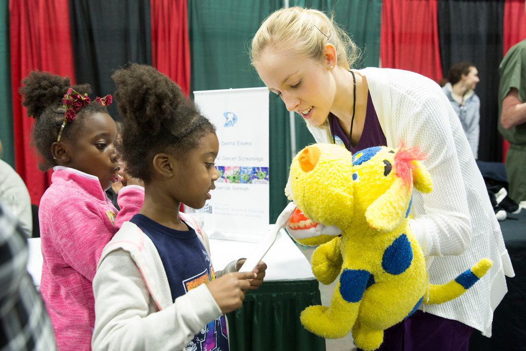Taylor Carter, 6, practiced brushing teeth on a puppet at the 2017 KwanzaaFest.