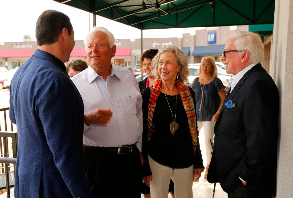 Eatzi's Market & Bakery CEO Adam Romo (left) visits with friends Tom Chambers and his wife, Patricia, and co-founder Jerry Meyer (right) during VIP night at the new University Park Village store in Fort Worth on May 9.