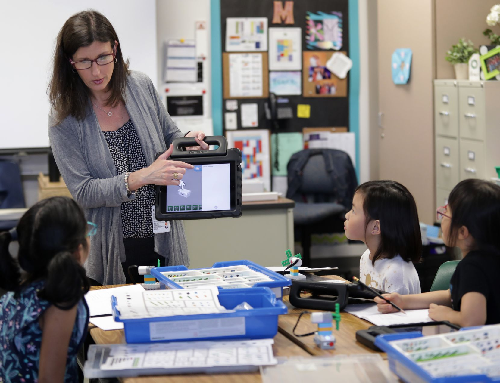 Teacher Kim Madden with students Friday at Isbell Elementary School in Frisco.