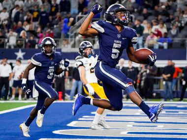 Frisco Lone Star running back Jaden Nixon celebrates as goes into to the end zone on an 18-yard touchdown run in overtime to give the Rangers a 33-27 victory over Highland Park in a Class 5A Division I Region II semifinal playoff football game at AT&T Stadium non Friday, Nov. 29, 2019, in Arlington. (Smiley N. Pool/The Dallas Morning News)