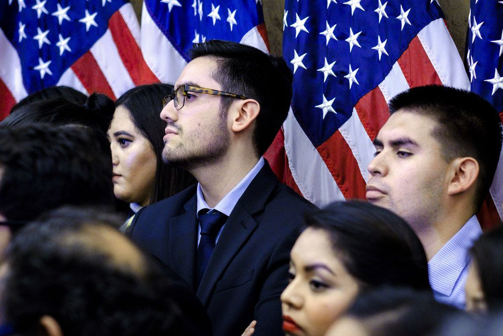 Dreamers invited to attend President Trump's first State of the Union Address look on Democratic lawmakers speak with reporters on January 30, 2018. Democratic leaders from the House and Senate welcomed the largest group of Dreamers to attend a State of the Union address.