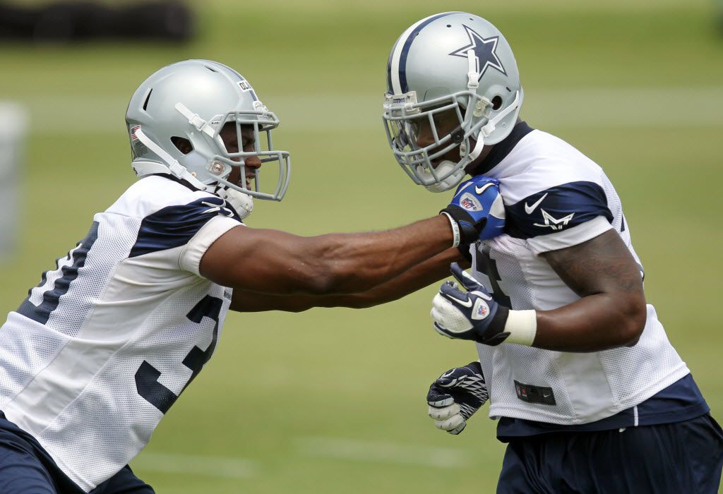 Dallas fullback Jamize Olawale (30) blocks DeMarcus Ware (94)during Dallas Cowboys football mini-camp on Tuesday, June 12, 2012.  (Jack White/The Dallas Morning News)