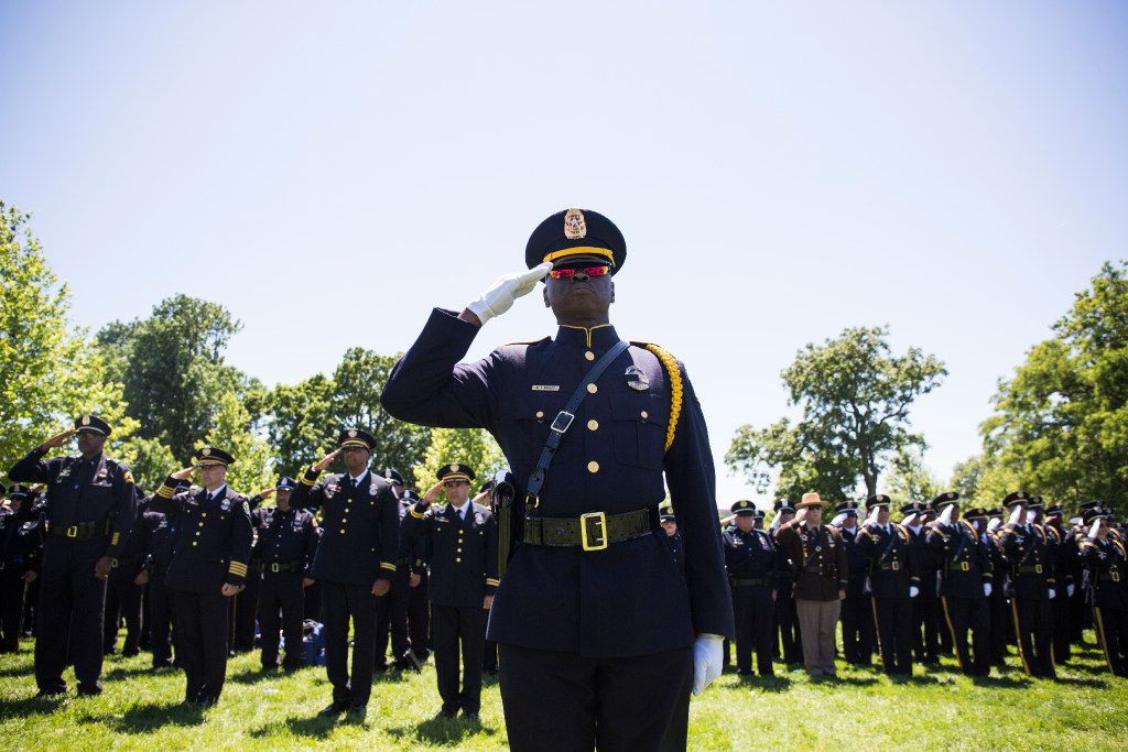 Dallas Police Sgt. Michael Bables salutes as names of Texan law enforcement officers are read during a roll call of fallen officers during the 36th Annual National Peace Officers' Memorial Service on the West Lawn of The U.S. Capitol Building Monday, May 15, 2017 in Washington, D.C.  The service, which takes place every year on May 15, honored federal, state, and local officers killed or disabled in the line of duty.