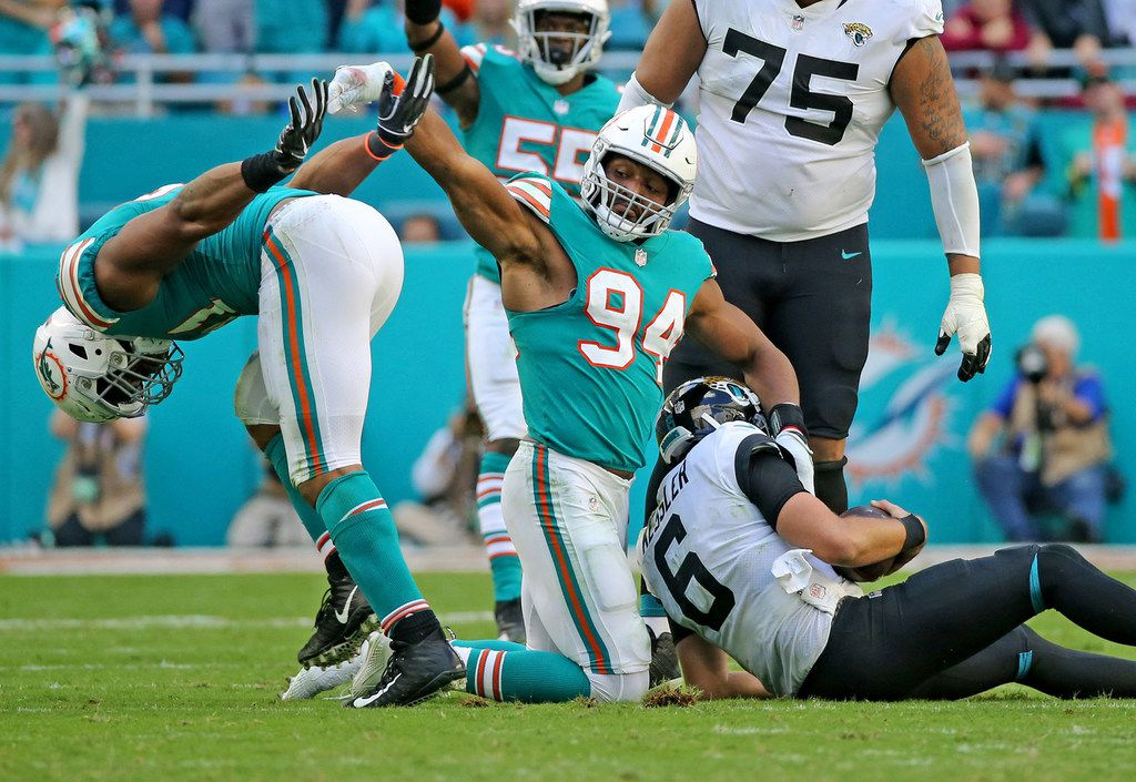 FILE - Dolphins defensive ends Cameron Wake (91) and Robert Quinn (94) celebrate a sack of Jaguars quarterback Cody Kessler (6) in the third quarter on Sunday, Dec. 23, 2018, at Hard Rock Stadium in Miami. (Charles Trainor Jr./Miami Herald/TNS)