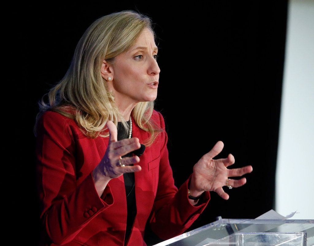 Abigail Spanberger gestures during a debate with Rep. Dave Brat, R-Va., at Germanna Community College in Culpeper, Va., on  Oct. 15, 2018. (AP Photo/Steve Helber)