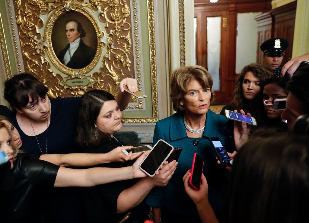 Sen. Lisa Murkowski, R-Alaska, speaks to members of the media after a vote to advance Brett Kavanaugh's nomination to the Supreme Court, on Capitol Hill, Friday, Oct. 4, 2018.