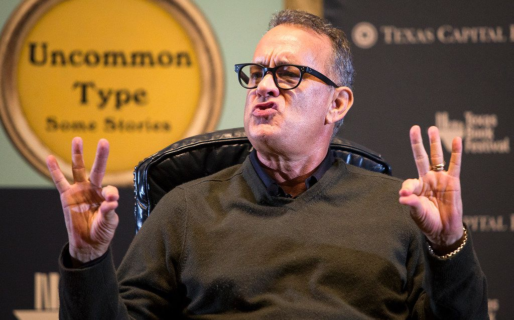 Tom Hanks mimics President Donald Trump while discussing his book, Uncommon Type, during the Texas Book Festival in Austin on Saturday, Nov. 4, 2017.