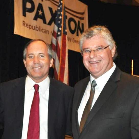 Andrew D. Leonie, right, is pictured with Attorney General Ken Paxton in a photograph posted to Leonie's Facebook in November.